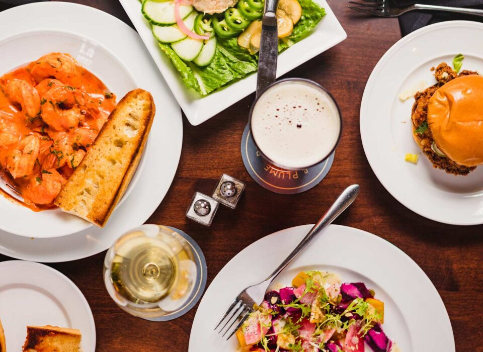 bird's eye view of different entrees on a wooden table