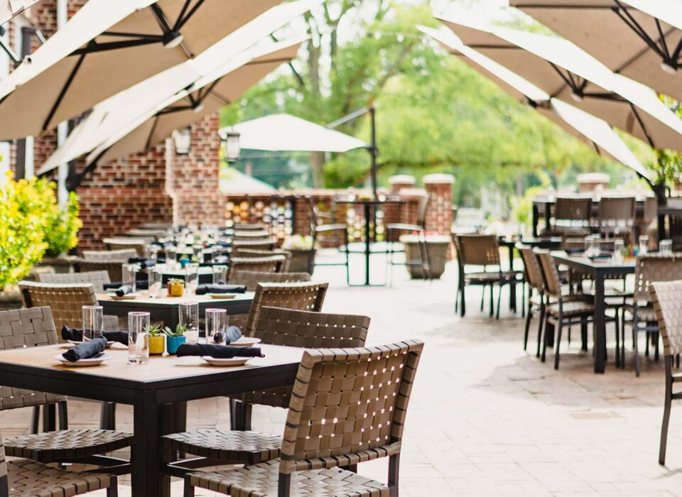 terrace seating with patio furniture and umbrellas