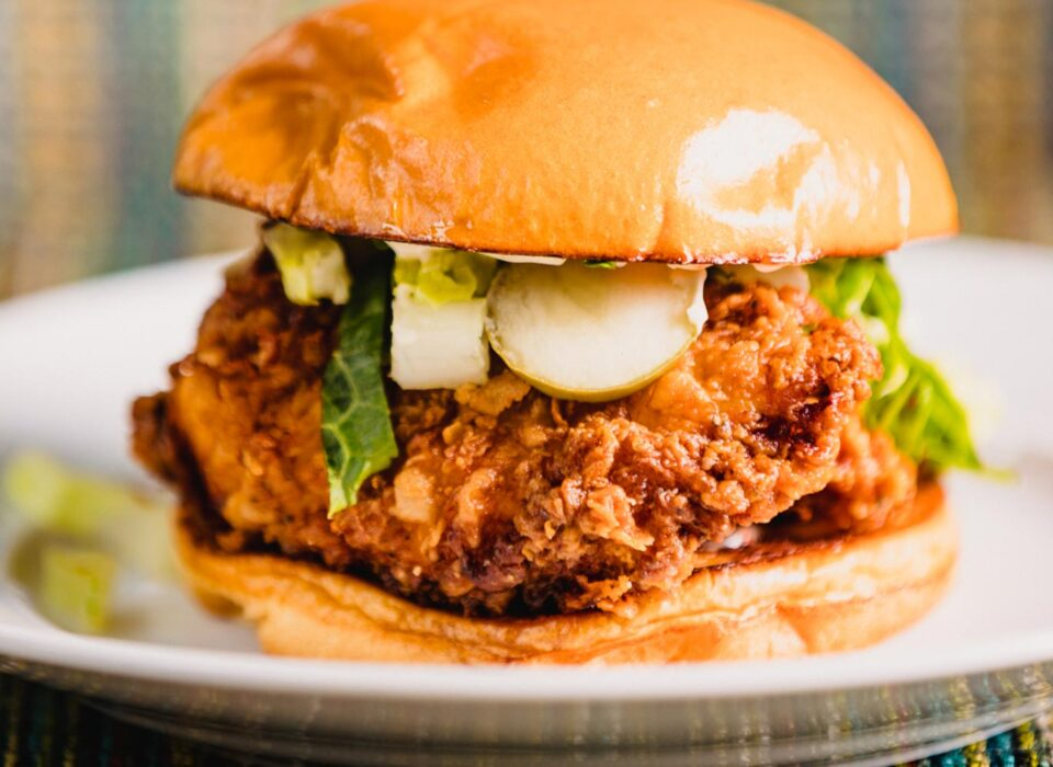 closeup of a crispy chicken sandwich with pickles